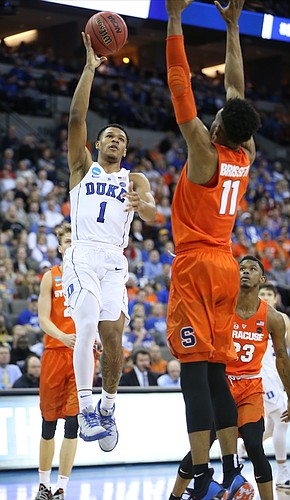 Duke guard Trevon Duval (1) floats a shot over Syracuse forward Oshae Brissett (11) during the second half, Friday, March 23, 2018 at CenturyLink Center in Omaha, Neb.