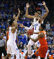 The Blue Devils pressure Syracuse guard Tyus Battle (25) during the second half, Friday, March 23, 2018 at CenturyLink Center in Omaha, Neb.