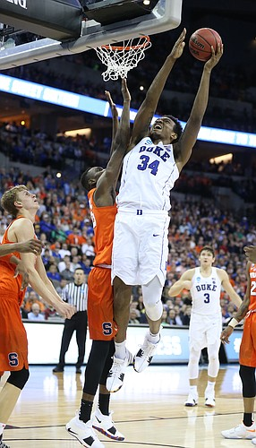 Duke forward Wendell Carter Jr (34) gets up for a bucket during the second half, Friday, March 23, 2018 at CenturyLink Center in Omaha, Neb.