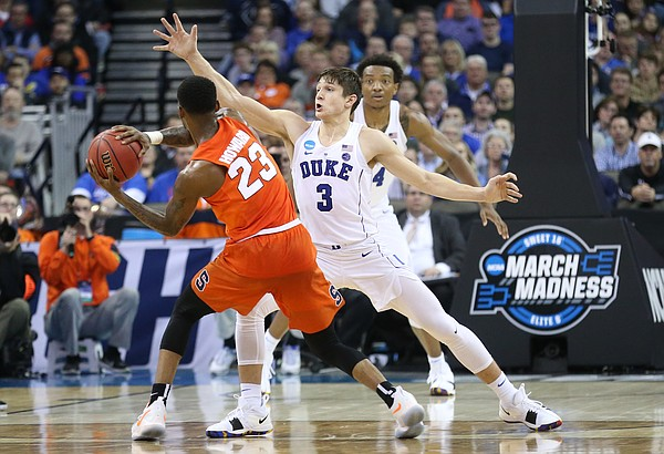Duke guard Grayson Allen (3) defends against a pass from Syracuse guard Frank Howard (23) during the second half, Friday, March 23, 2018 at CenturyLink Center in Omaha, Neb.