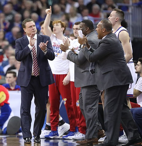 Kansas head coach Bill Self applauds the play of his team during the first half, Friday, March 23, 2018 at CenturyLink Center in Omaha, Neb.