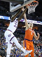 Kansas forward Silvio De Sousa (22) puts in a lob jam before Clemson forward Mark Donnal (5) during the first half, Friday, March 23, 2018 at CenturyLink Center in Omaha, Neb.