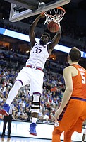 Kansas center Udoka Azubuike (35) delivers a jam before Clemson forward Mark Donnal (5) during the first half, Friday, March 23, 2018 at CenturyLink Center in Omaha, Neb.