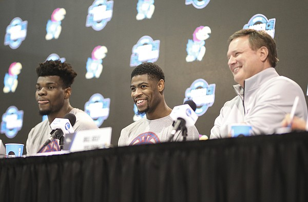 Kansas guard Malik Newman laughs between Kansas head coach Bill Self and Kansas center Udoka Azubuike during a press conference on Saturday, March 24, 2018 at CenturyLink Center in Omaha, Neb.