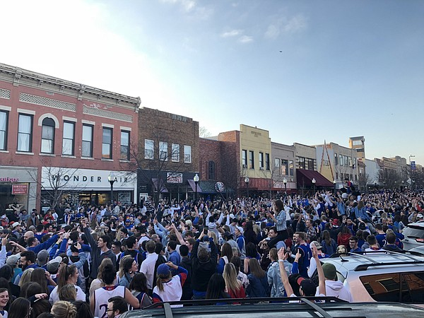 Kansas basketball fans fill Massachusetts Street after the Jayhawks advanced to the Final Four, Saturday, March 25, 2018.