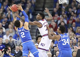 Kansas forward Silvio De Sousa (22) blocks a shot by Duke guard Gary Trent Jr. (2) during the second half, Sunday, March 25, 2018 at CenturyLink Center in Omaha, Neb.