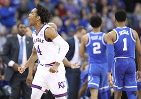Kansas guard Devonte' Graham (4) celebrates a Jayhawk run during the second half, Sunday, March 25, 2018 at CenturyLink Center in Omaha, Neb.