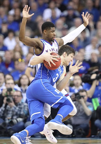 Kansas guard Malik Newman (14) defends against Duke guard Grayson Allen (3) during the second half, Sunday, March 25, 2018 at CenturyLink Center in Omaha, Neb.