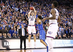 Kansas guard Sviatoslav Mykhailiuk (10) puts up a three to force overtime with seconds remaining in regulation, Sunday, March 25, 2018 at CenturyLink Center in Omaha, Neb.