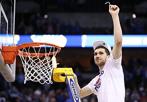 Kansas guard Sviatoslav Mykhailiuk (10) holds up his share of the net as the Jayhawks celebrate a trip to the Final Four following their 85-81 overtime victory over Duke on Sunday in Omaha, Neb.