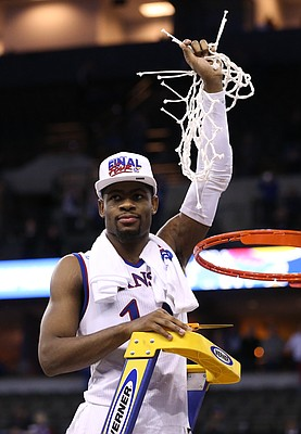 Kansas guard Malik Newman (14), the MVP for the Midwest Regional, hoists the remainder of the net as the Jayhawks celebrate a trip to the Final Four following their 85-81 overtime victory over Duke on Sunday in Omaha, Neb.