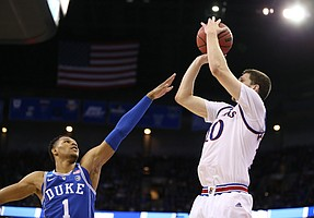 Kansas guard Sviatoslav Mykhailiuk (10) puts up a three over Duke guard Trevon Duval (1) during the second half, Sunday, March 25, 2018 at CenturyLink Center in Omaha, Neb.