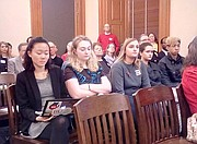 Lawrence High School students Chisato Kimura, left, Samantha Turner, Quinlan Muller, Anna Osterhaus and  Rollin Love listen Tuesday, March 27, 2018, during a legislative committee hearing on a bill that would make it easier for school districts to allow teachers to carry firearms in class. Some of the students planned to testify against the bill but were not called upon to speak.