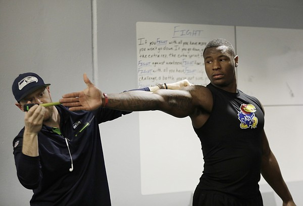 Dorance Armstrong has his wingspan measured during the Kansas football Pro Day Tuesday at the Anderson Family Football Complex.