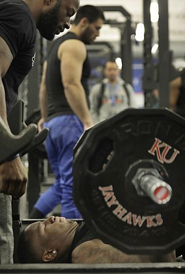 Dorance  Armstrong tests his bench pressing strength during the Kansas football Pro Day on Tuesday at the Anderson Family Football Complex.