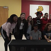 Members of the Lawrence High girls basketball team gather for a photo with senior E'Lease Stafford, who signed her letter of intent on Wednesday to play at the next level for East Tennessee State.
