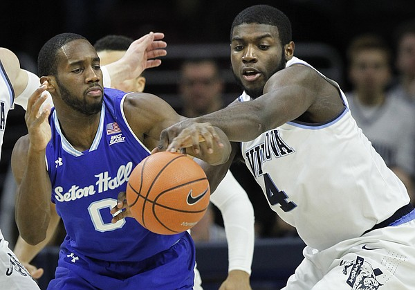 Villanova forward Eric Paschall (4) gets the ball away from Seton Hall guard Khadeen Carrington (0) during the second half of an NCAA college basketball game, Sunday, Feb. 4, 2018, in Philadelphia, Pa. (AP Photo/Laurence Kesterson)
