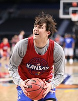 Kansas forward James Sosinski (55) pump fakes before putting up a shot during a practice on Friday, March 30, 2018 at the Alamodome in San Antonio, Texas.