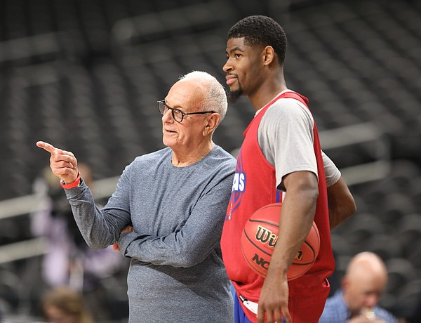 Kansas guard Malik Newman (14) and former Kansas head coach Larry Brown talk on the sidelines on Friday, March 30, 2018 at the Alamodome in San Antonio, Texas.
