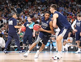 Villanova guard Mikal Bridges (25) drives against Villanova forward Dylan Painter (42) during a practice on Friday, March 30, 2018 at the Alamodome in San Antonio, Texas.