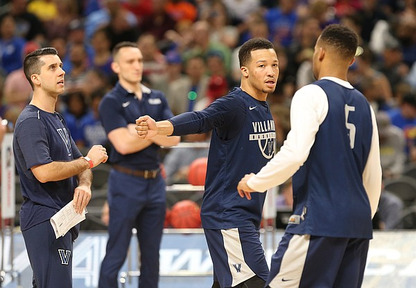 Villanova guard Jalen Brunson (1) slaps hands with Villanova guard Phil Booth (5) during a practice on Friday, March 30, 2018 at the Alamodome in San Antonio, Texas.