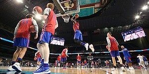 Kansas forward Silvio De Sousa (22) comes in for a dunk during a practice on Friday, March 30, 2018 at the Alamodome in San Antonio, Texas.