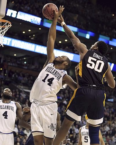 West Virginia's Sagaba Konate, right, defends a shot by Villanova's Omari Spellman during the second half of an NCAA men's college basketball tournament regional semifinal, Friday, March 23, 2018, in Boston.