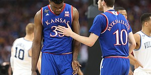 Kansas guard Sviatoslav Mykhailiuk (10) gives Kansas center Udoka Azubuike (35) a slap on the chest as Azubuike checks out during the first half, Saturday, March 31, 2018 at the Alamodome in San Antonio, Texas.