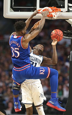 Kansas center Udoka Azubuike (35) dunks against Villanova forward Dhamir Cosby-Roundtree (21) during the first half, Saturday, March 31, 2018 at the Alamodome in San Antonio, Texas.