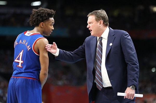 Kansas head coach Bill Self and Kansas guard Devonte' Graham (4) have a talk on the sidelines during a break in action in the second half, Saturday, March 31, 2018 at the Alamodome in San Antonio, Texas.