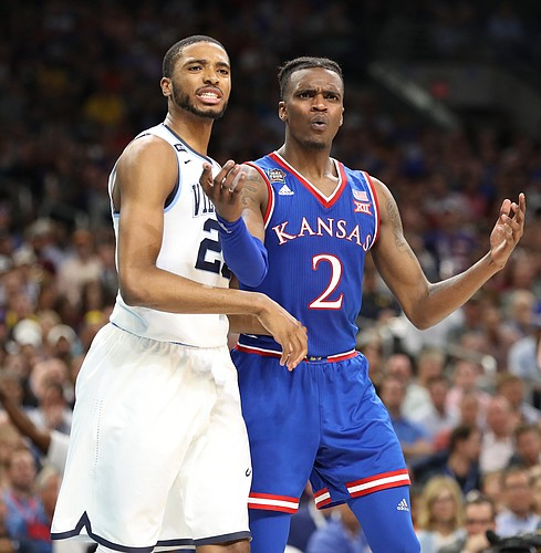 Kansas guard Lagerald Vick (2) looks for a call after knocking a ball from Villanova guard Mikal Bridges (25) during the second half, Saturday, March 31, 2018 at the Alamodome in San Antonio, Texas.