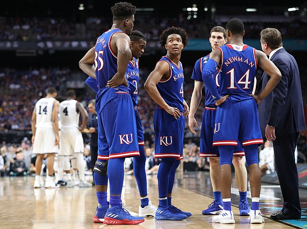 Kansas guard Devonte' Graham (4) glances at the scoreboard during a timeout in the second half, Saturday, March 31, 2018 at the Alamodome in San Antonio, Texas.
