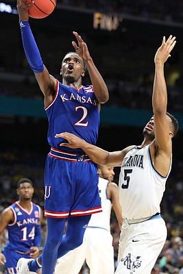 Kansas guard Lagerald Vick (2) elevates to the bucket past Villanova guard Phil Booth (5) during the second half, Saturday, March 31, 2018 at the Alamodome in San Antonio, Texas.