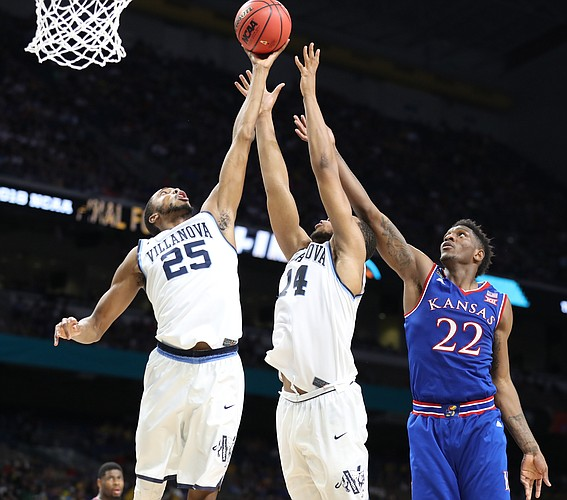 Villanova guard Mikal Bridges (25) and Villanova forward Omari Spellman (14) get a rebound from Kansas forward Silvio De Sousa (22) during the second half, Saturday, March 31, 2018 at the Alamodome in San Antonio, Texas.
