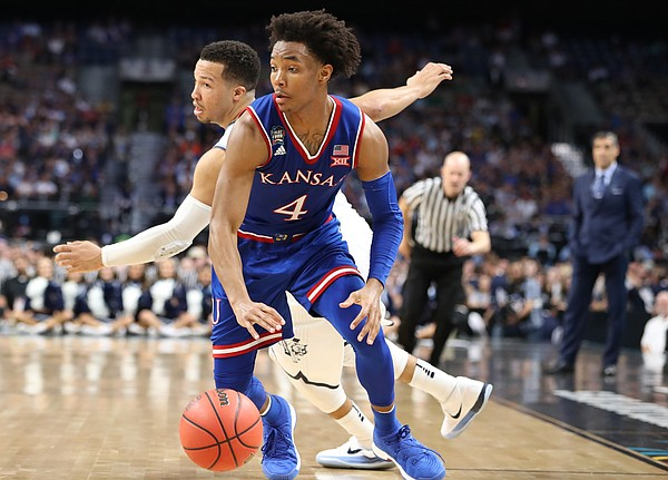 Kansas guard Devonte' Graham (4) steals a ball from Villanova guard Jalen Brunson (1) during the second half, Saturday, March 31, 2018 at the Alamodome in San Antonio, Texas.