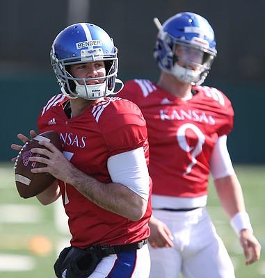 Kansas quarterback Peyton Bender (7) drops back to pass during practice on Wednesday, April 4, 2018, as Carter Stanley (9) observes.