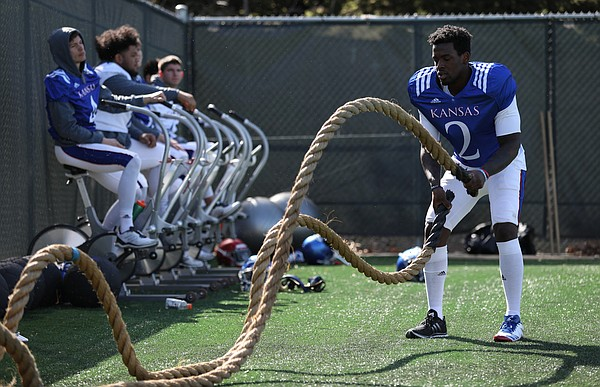 Kansas wide receiver Daylon Charlot (2) works out his arms on the ropes during practice on Wednesday, April 4, 2018.
