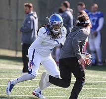 Kansas cornerback Corione Harris chases down a target during practice on Wednesday, April 4, 2018.