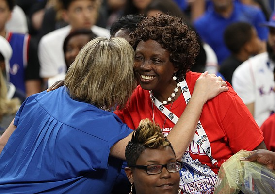 Florence Azuonuwu, mother of Kansas center Udoka Azubuike gets a welcoming hug from a KU fan prior to tipoff on Saturday, March 31, 2018 at the Alamodome in San Antonio. Azuonuwu traveled from Delta, Nigeria to see her son play, whom she hasn't seen in six years.
