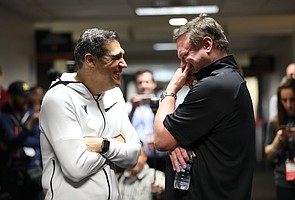 Villanova head coach Jay Wright, left, and Kansas head coach Bill Self have a laugh in the hallway while waiting to do a joint CBS interview on Thursday, March 29, 2018 at the Alamodome in San Antonio.