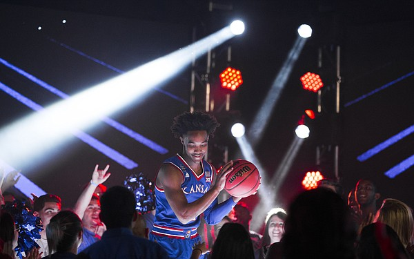 Kansas guard Devonte' Graham pump fakes with a ball as he dances on a stage before fans during a video recording with Turner CBS on Thursday, March 29, 2018 at the Alamodome in San Antonio.