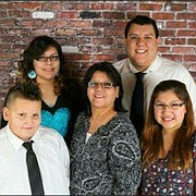 Trevor J. Mohawk, top right, is pictured with relatives.
