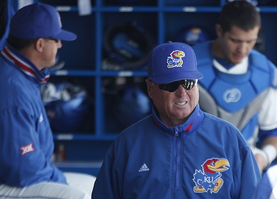 Kansas baseball coach Ritch Price watches the Jayhawks from the dugout during a home game against No. 5 Texas Tech, Saturday, April 8, 2018, at Hoglund Ballpark.