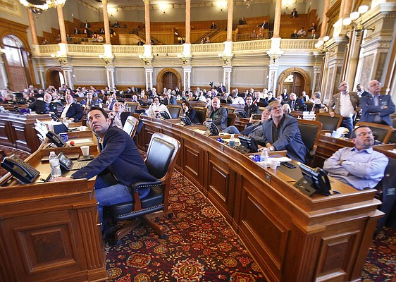 Members of the Kansas House look up to the voting board after casting their votes on an amendment to a school funding compromise by House and Senate leadership on Saturday, April 7, 2018, at the Statehouse in Topeka, Kan. (Chris Neal/The Topeka Capital-Journal via AP)