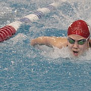 Lawrence High's Emily Guo swims to a first-place finish in the 200-yard medley relay on Tuesday at the Free State Invite at the Lawrence Indoor Aquatic Center.
