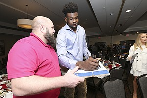 Kansas center Udoka Azubuike signs an autograph for a fan following the Kansas basketball banquet on Tuesday, April 10, 2018 at the DoubleTree Hotel in Lawrence.