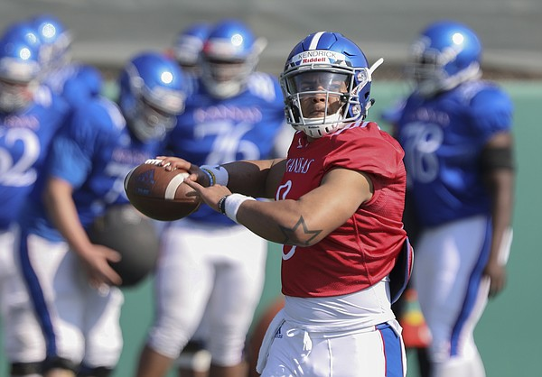 Kansas sophomore quarterback Miles Kendrick pulls back to throw during practice on Tuesday, April 10, 2018.