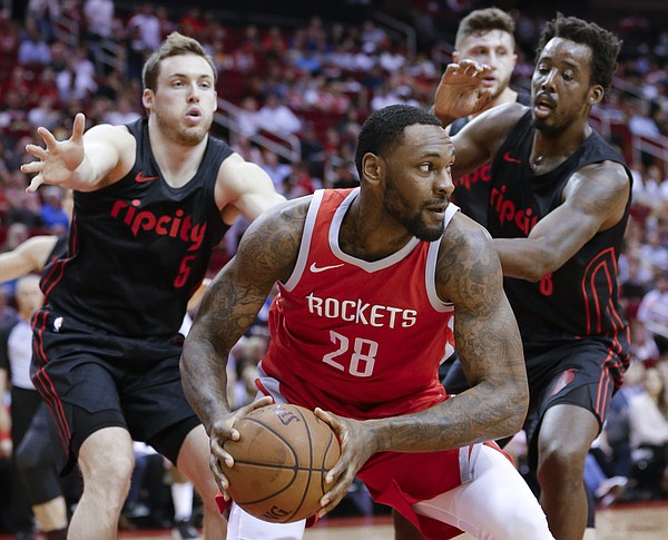 Houston Rockets forward Tarik Black (28) looks to pass under pressure from Portland Trail Blazers guard Pat Connaughton (5) and Portland Trail Blazers forward Al-Farouq Aminu (8) during the first half of an NBA basketball game Thursday, April 5, 2018, in Houston. (AP Photo/Michael Wyke)