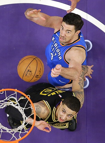 Los Angeles Lakers forward Kyle Kuzma, below, and Oklahoma City Thunder forward Nick Collison wait for a rebound during the second half of an NBA basketball game Thursday, Feb. 8, 2018, in Los Angeles. The Lakers won 106-81. (AP Photo/Mark J. Terrill)