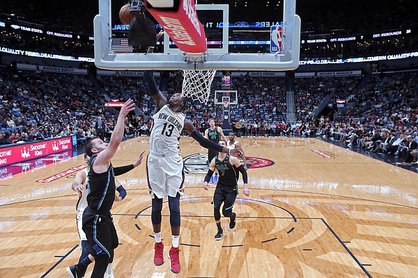 New Orleans Pelicans forward Cheick Diallo (13) tries to block a shot by Dallas Mavericks guard J.J. Barea in the second half of an NBA basketball game in New Orleans, Tuesday, March 20, 2018. The Pelicans won 115-105. (AP Photo/Gerald Herbert)